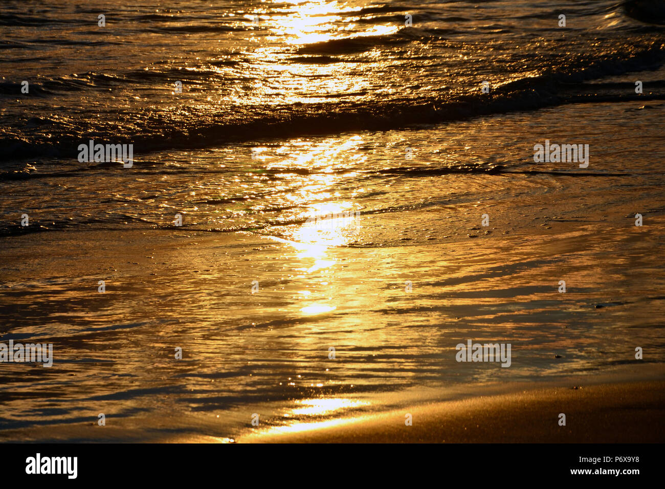 Wave Of A Sandy Beach And Glare Of The Sun Golden
