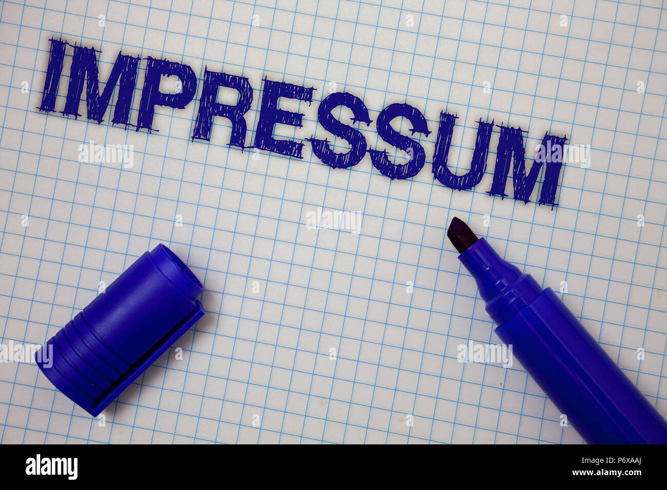 Handwriting text Impressum. Concept meaning Impressed Engraved Imprint German statement ownership authorship Squared notebook page ideas messages blue - Stock Image