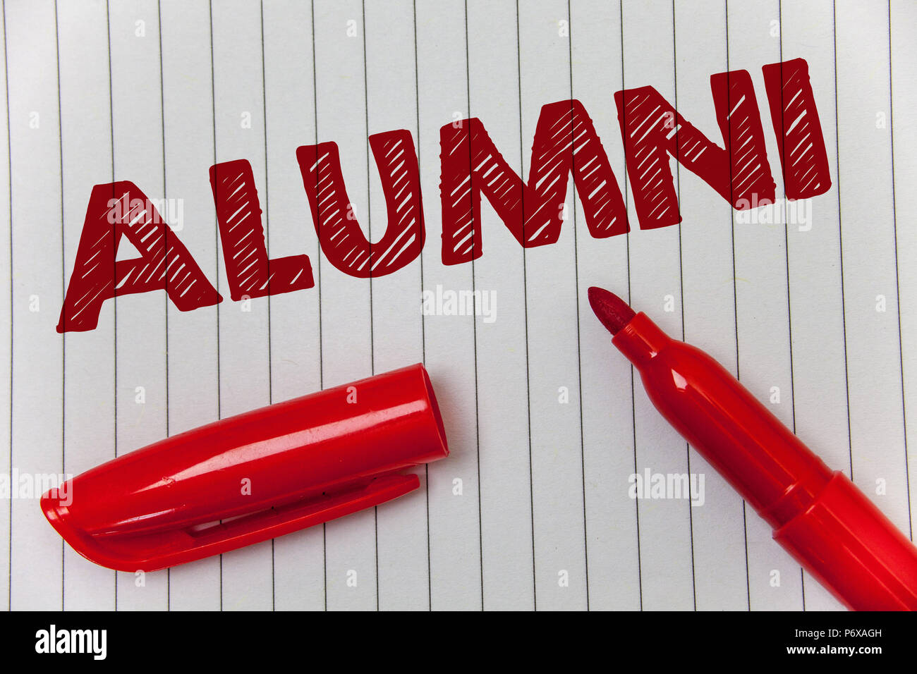 Text sign showing Alumni. Conceptual photo Alum Old graduate Postgraduate Gathering College Academy Celebration Ideas message notebook paper open mark - Stock Image