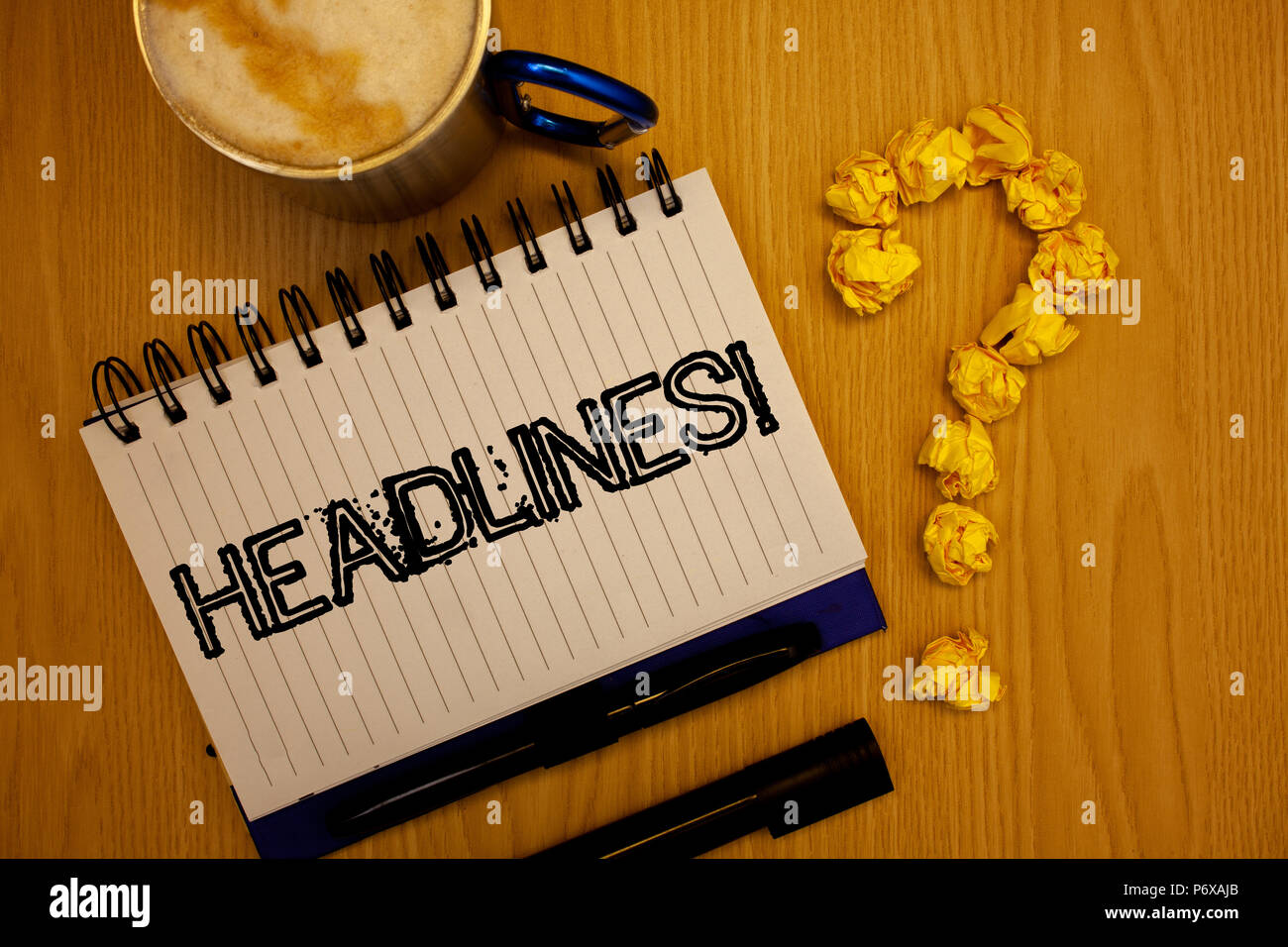 Handwriting text Headlines Motivational Call. Concept meaning Heading at the top of an article in newspaper Ideas grunge notebook coffee cup crumpled  - Stock Image