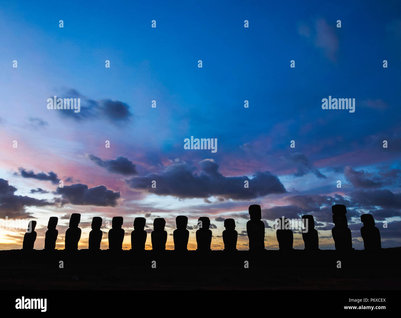 Moais in Ahu Tongariki at sunrise, Rapa Nui National Park, Easter Island, Chile - Stock Image