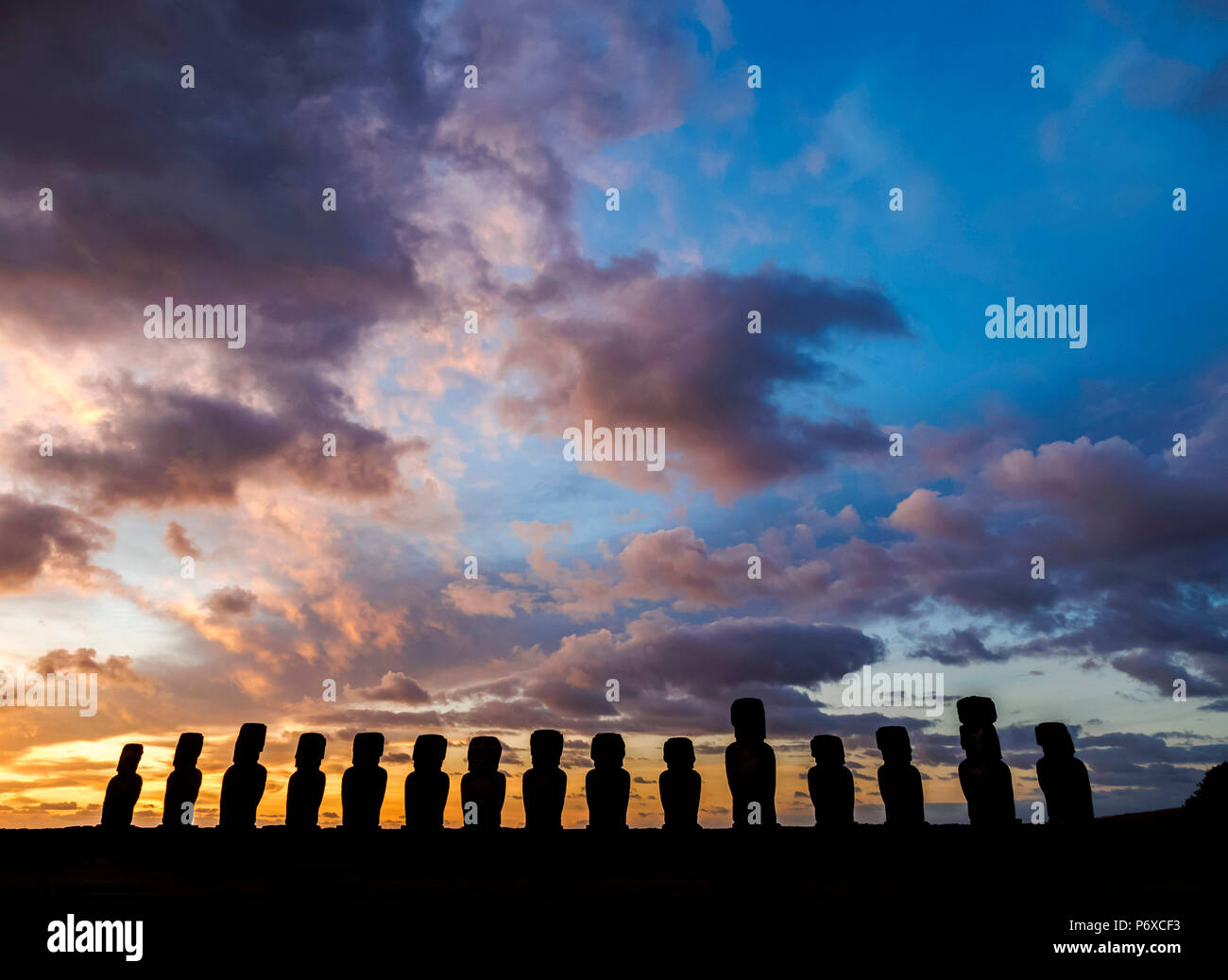 Moais in Ahu Tongariki at sunrise, Rapa Nui National Park, Easter Island, Chile - Stock Image