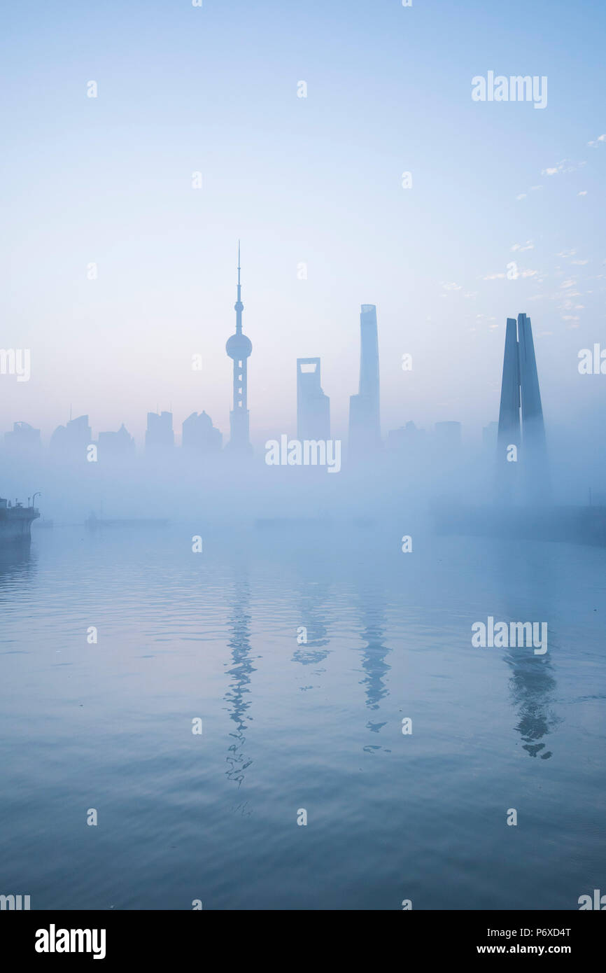 Skyline of Pudong on a foggy November morning, Shanghai, China Stock Photo