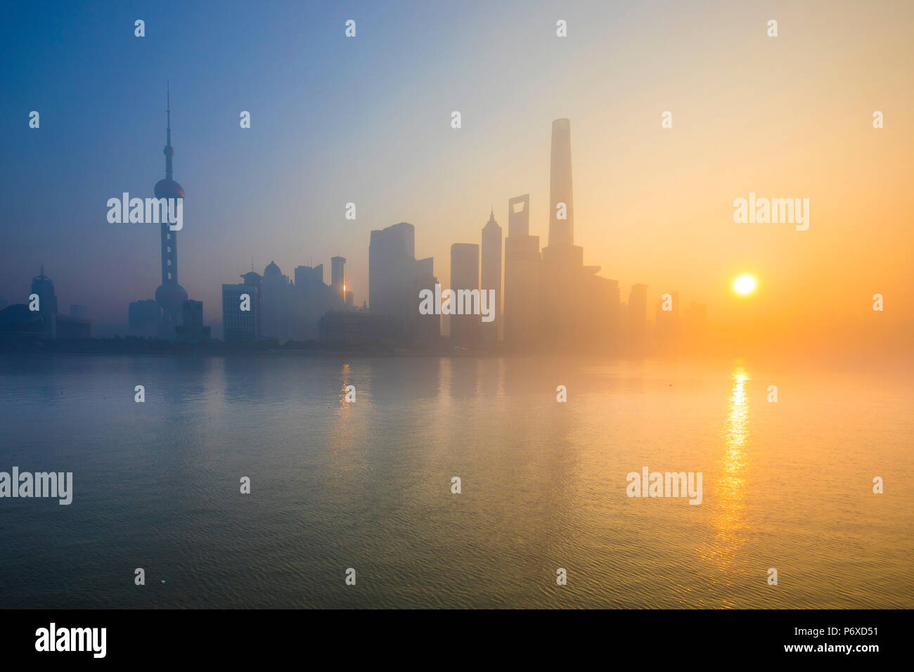 Skyline of Pudong from The Bund on a foggy November morning, Shanghai, China Stock Photo