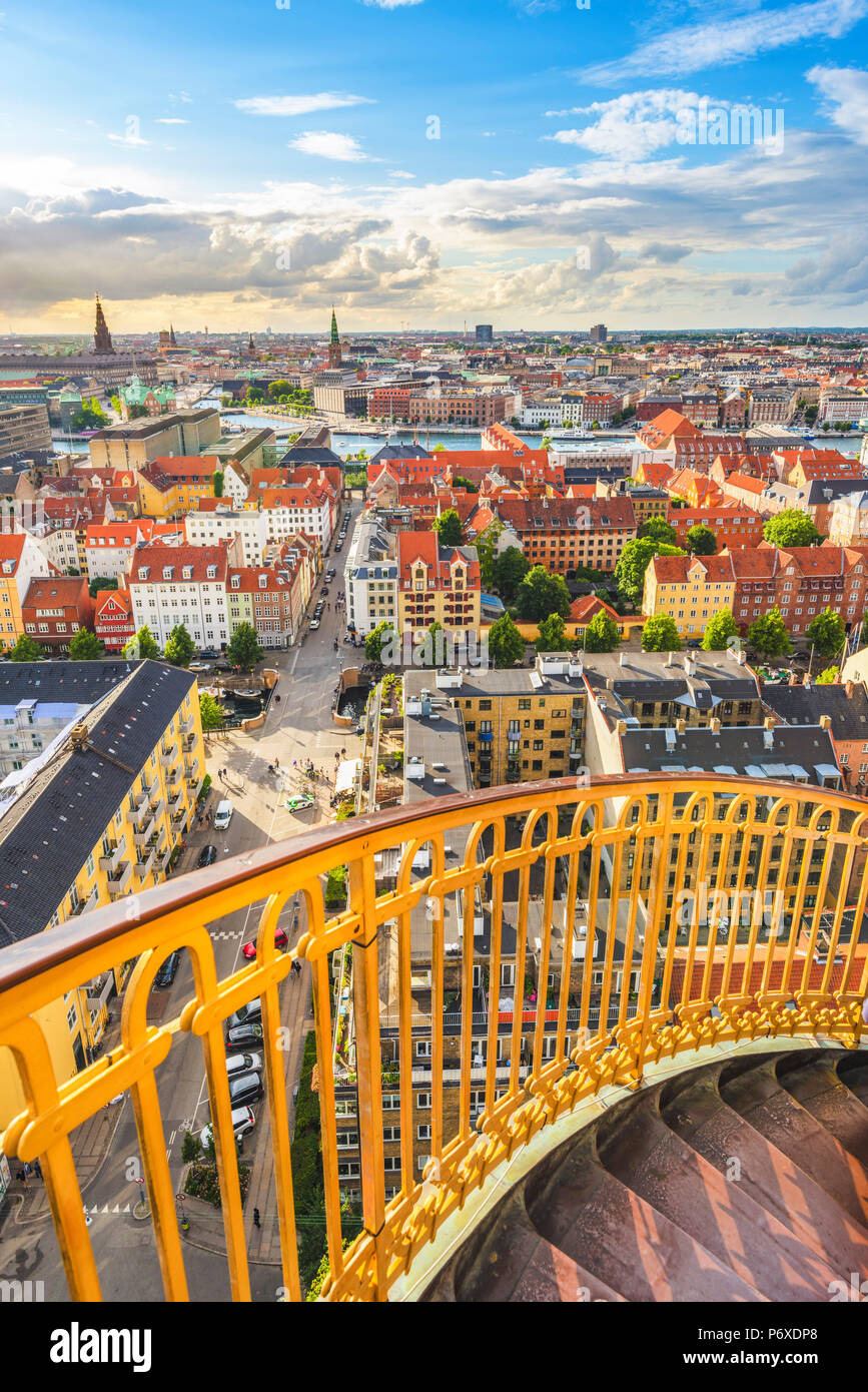 Copenhagen, Hovedstaden, Denmark. The golden staircase of the Church of Our Savior and the city skyline. - Stock Image