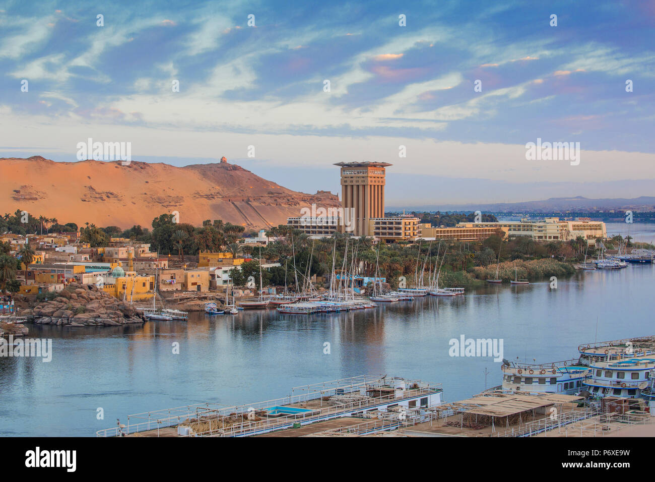 Egypt, Upper Egypt, Aswan, View of River Nile looking towards the Movenpick Resort and Tombs of the Nobles - Stock Image