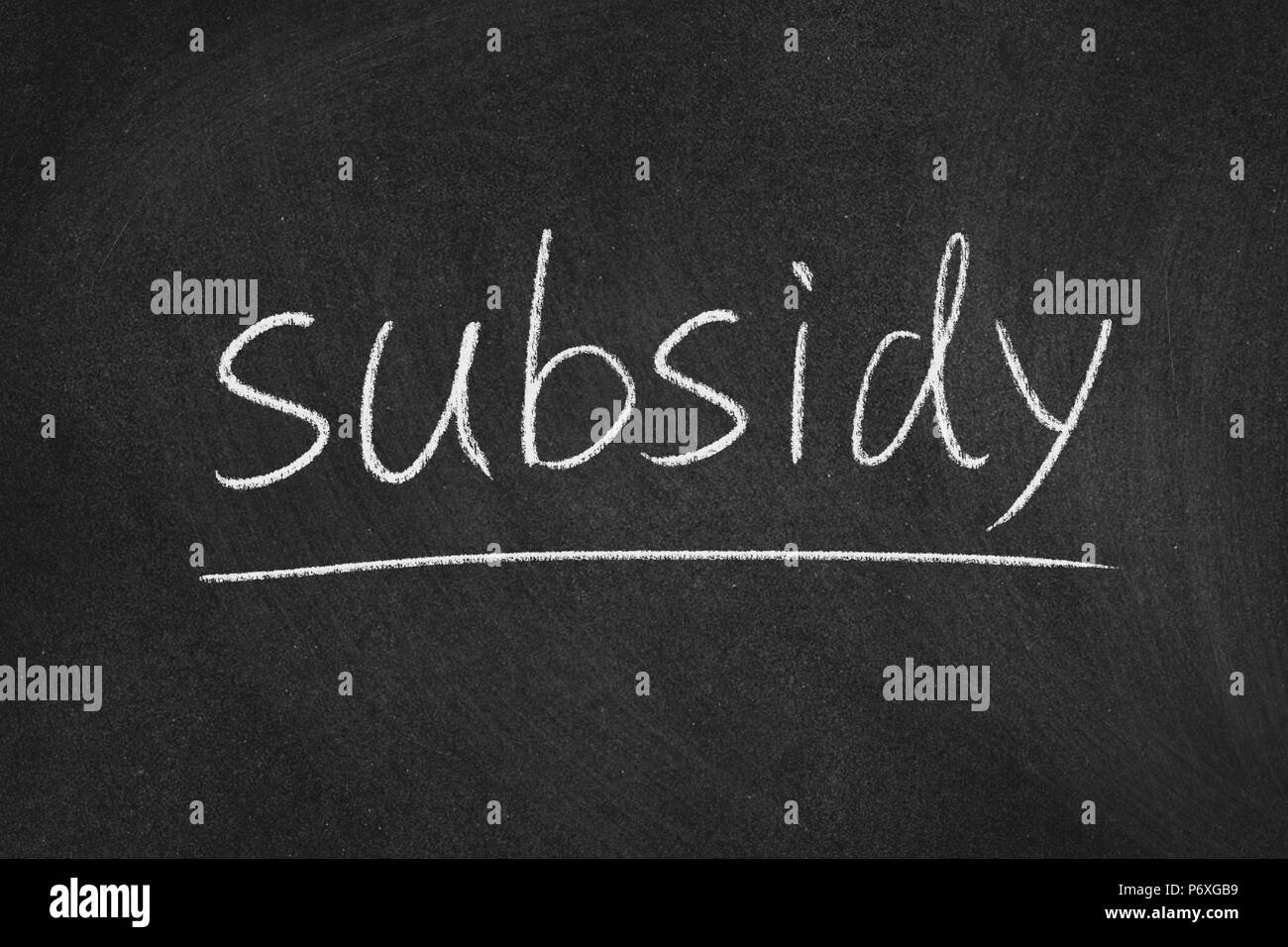 subsidy concept word on a blackboard background - Stock Image