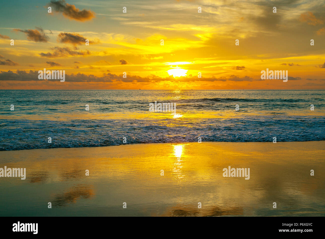Colorful sunset on Karon beach. Phuket Island in Thailand. - Stock Image