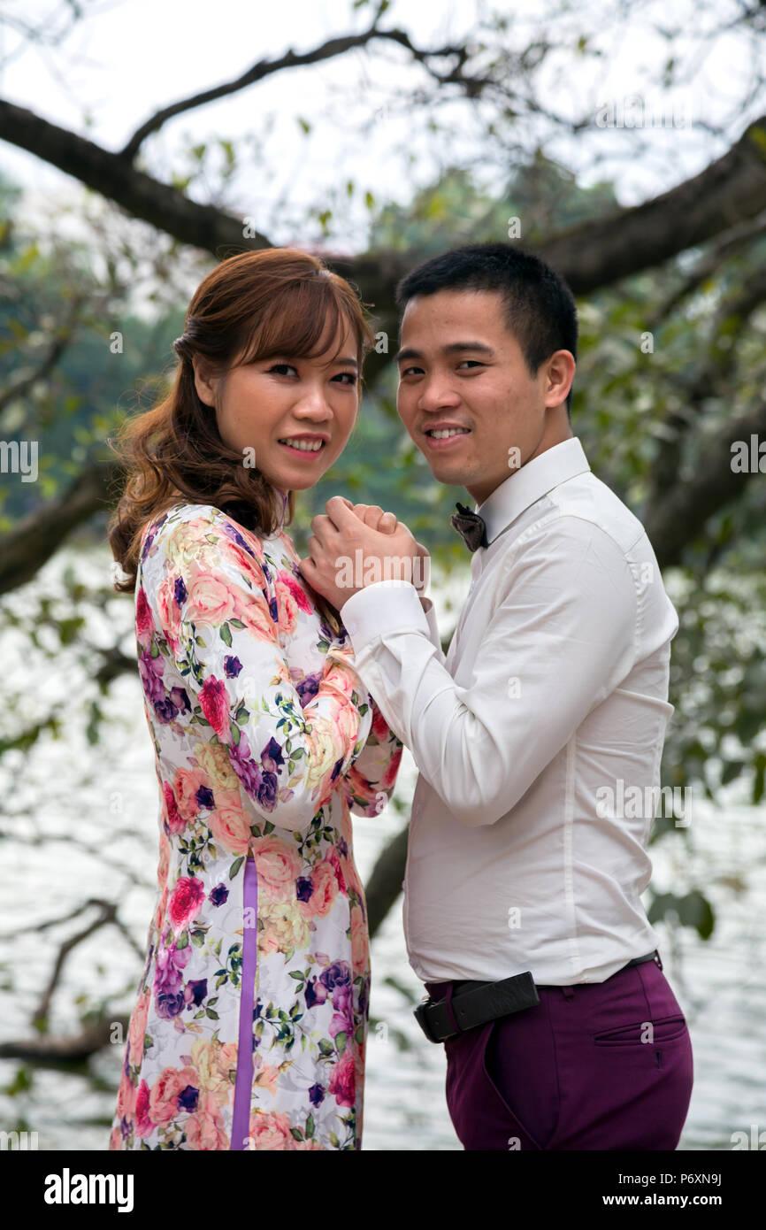 Happy couple at Hoan Kiem lake , Hanoi , Vietnam - Stock Image
