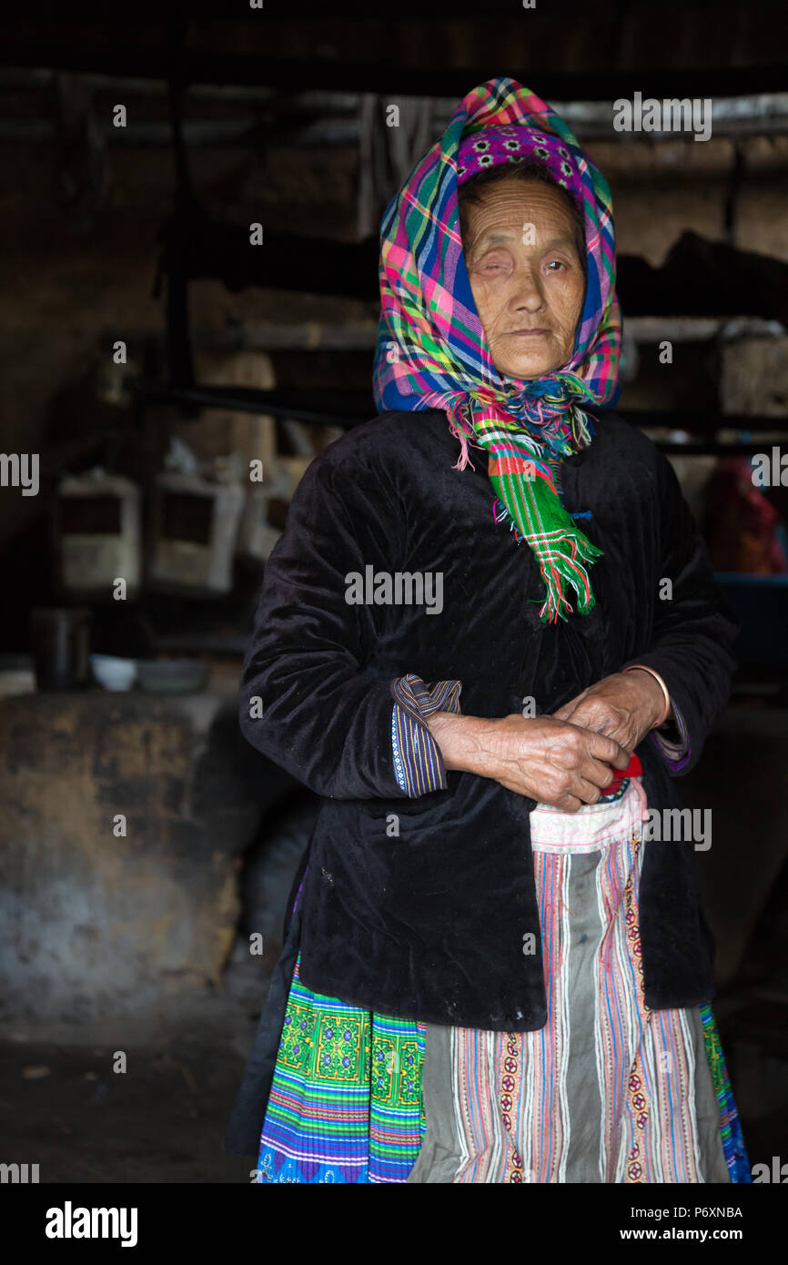 Old Hmong lady in her house in Sapa , Vietnam - Stock Image