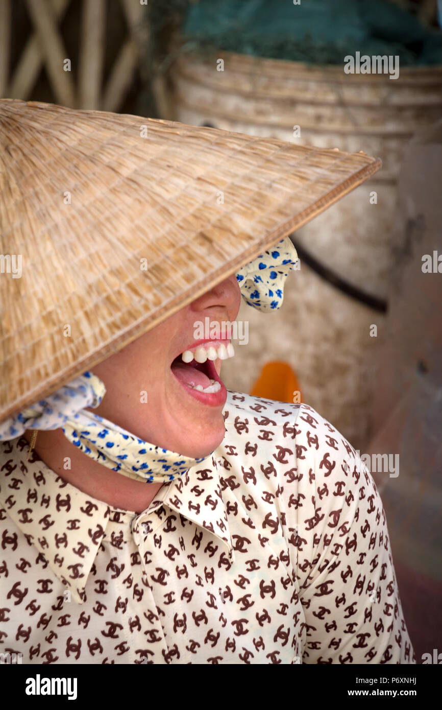 Portrait of Woman with traditional conical hat , Vietnam - Stock Image