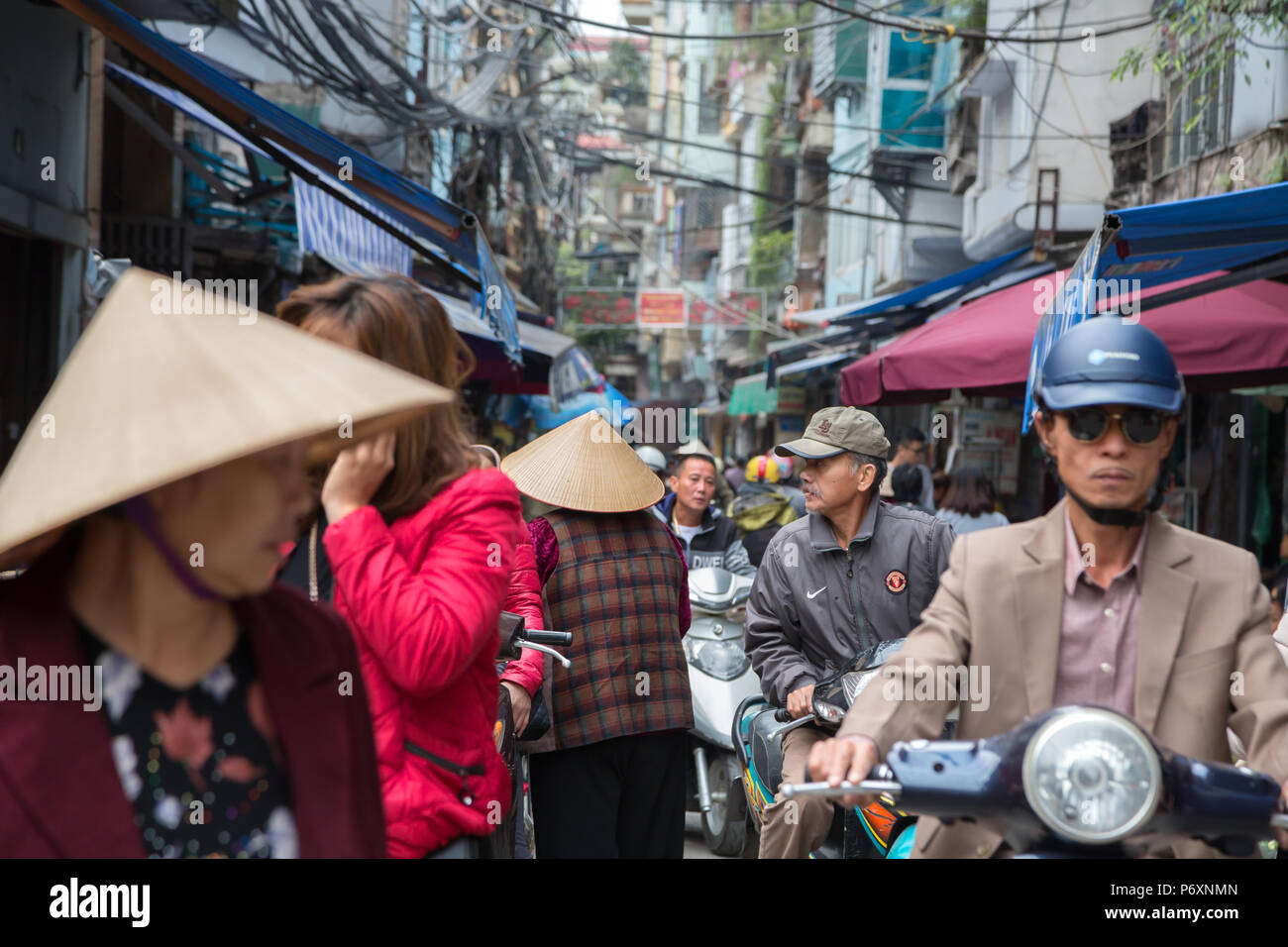 Crowd in a busy street of Hanoi , Vietnam - Stock Image