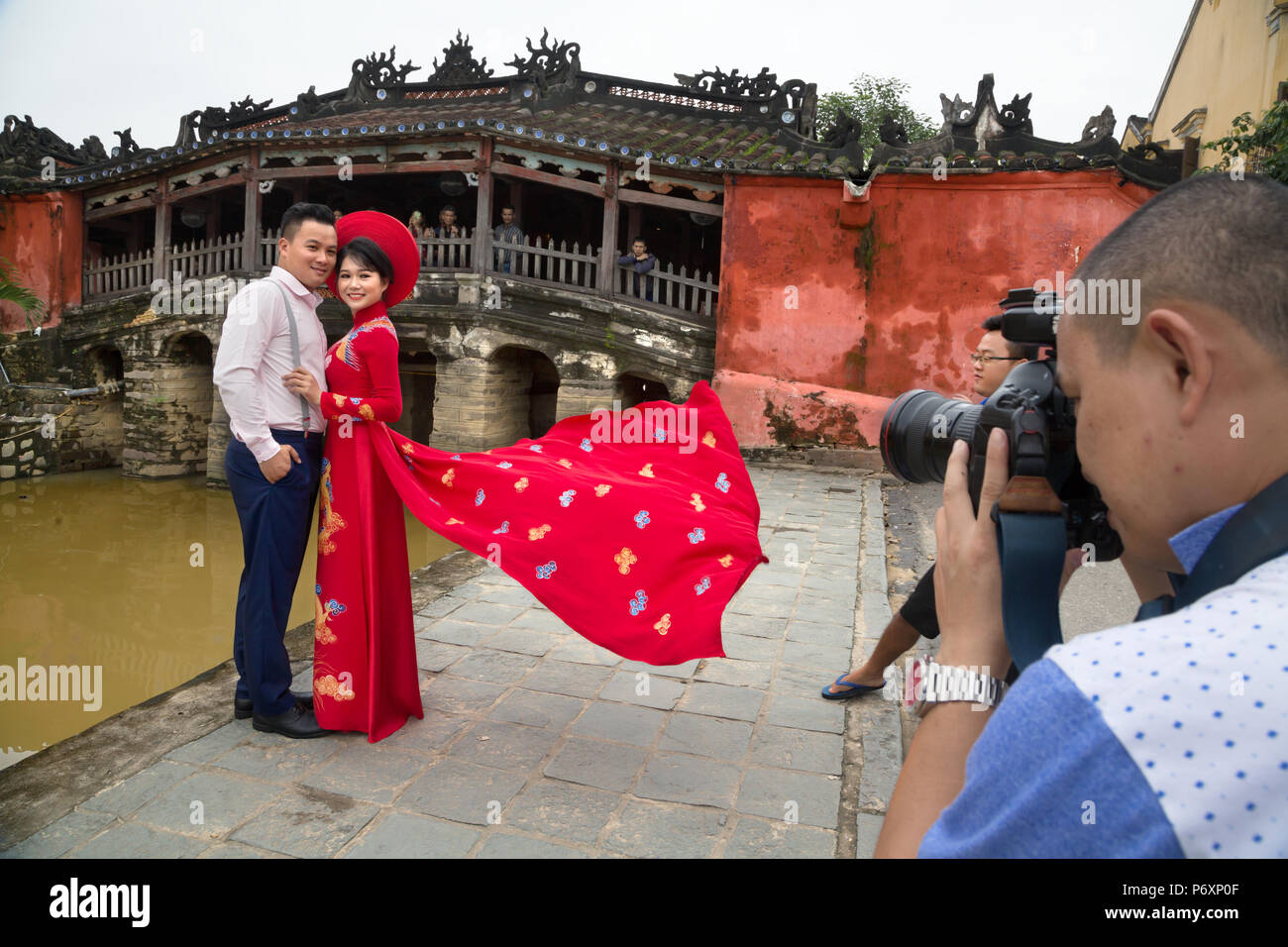 Photo session in front of the Japanese covered bridge, Hoi An , Vietnam - Stock Image