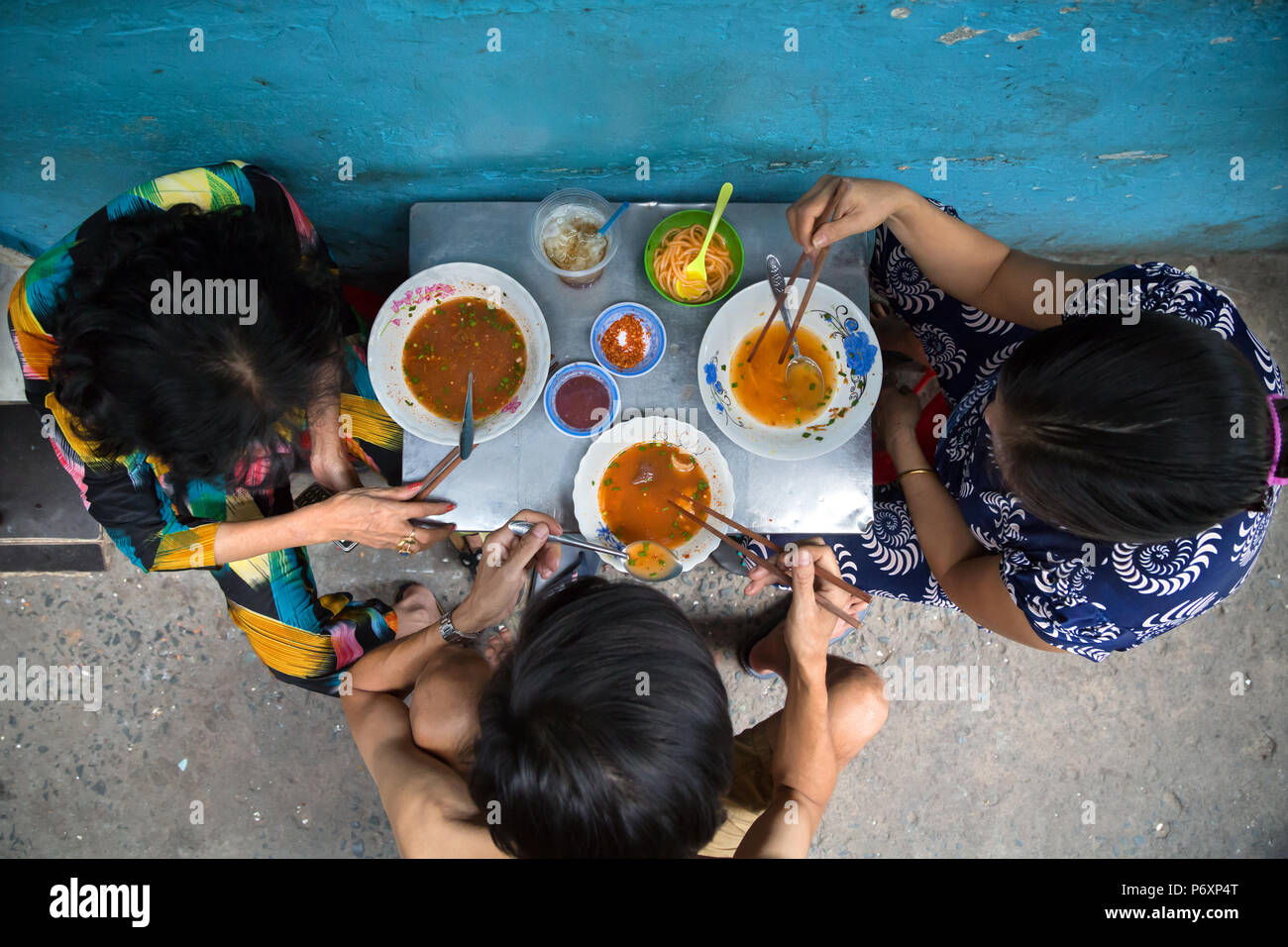 People eat tradition noodle soup called 'pho' in Saigon , Vietnam - Stock Image
