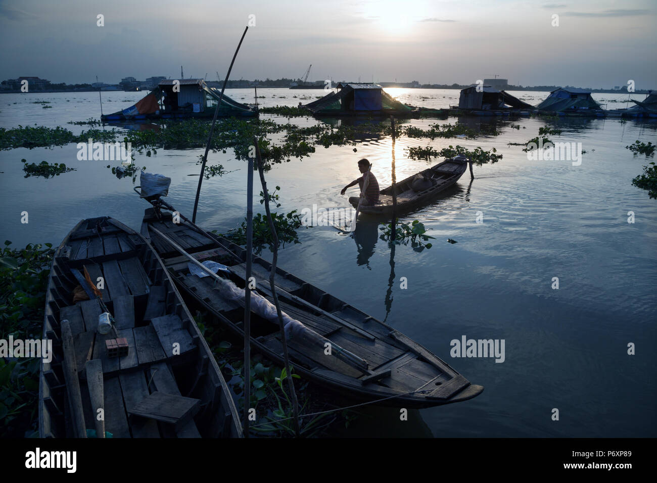 Amazing sunset landscape on Mekong river with boat from An Binh island , Vietnam - Stock Image