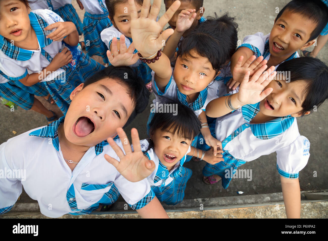 Kids with uniform  go crazy after school on An Binh island,Vietnam - Stock Image