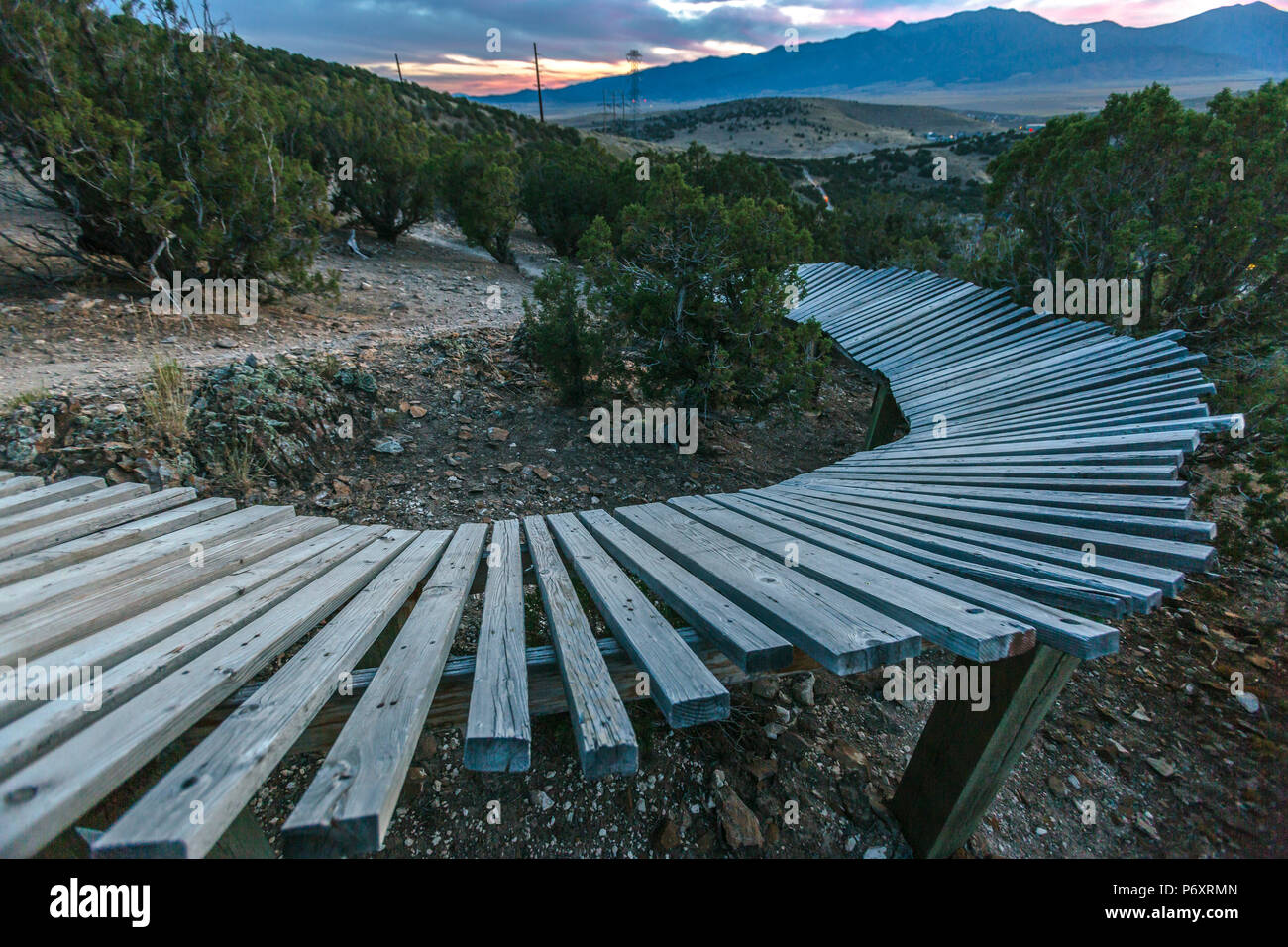 Curve of a wooden berm at sunset - Stock Image