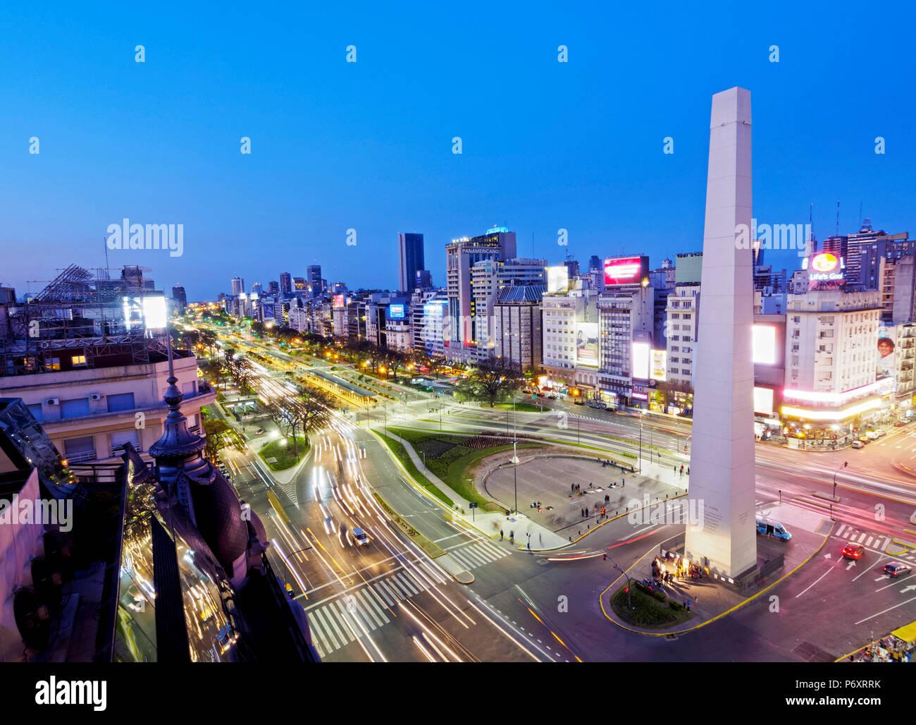 Argentina, Buenos Aires Province, City of Buenos Aires, Twilight view of 9 de Julio Avenue, Plaza de la Republica and Obelisco de Buenos Aires. - Stock Image