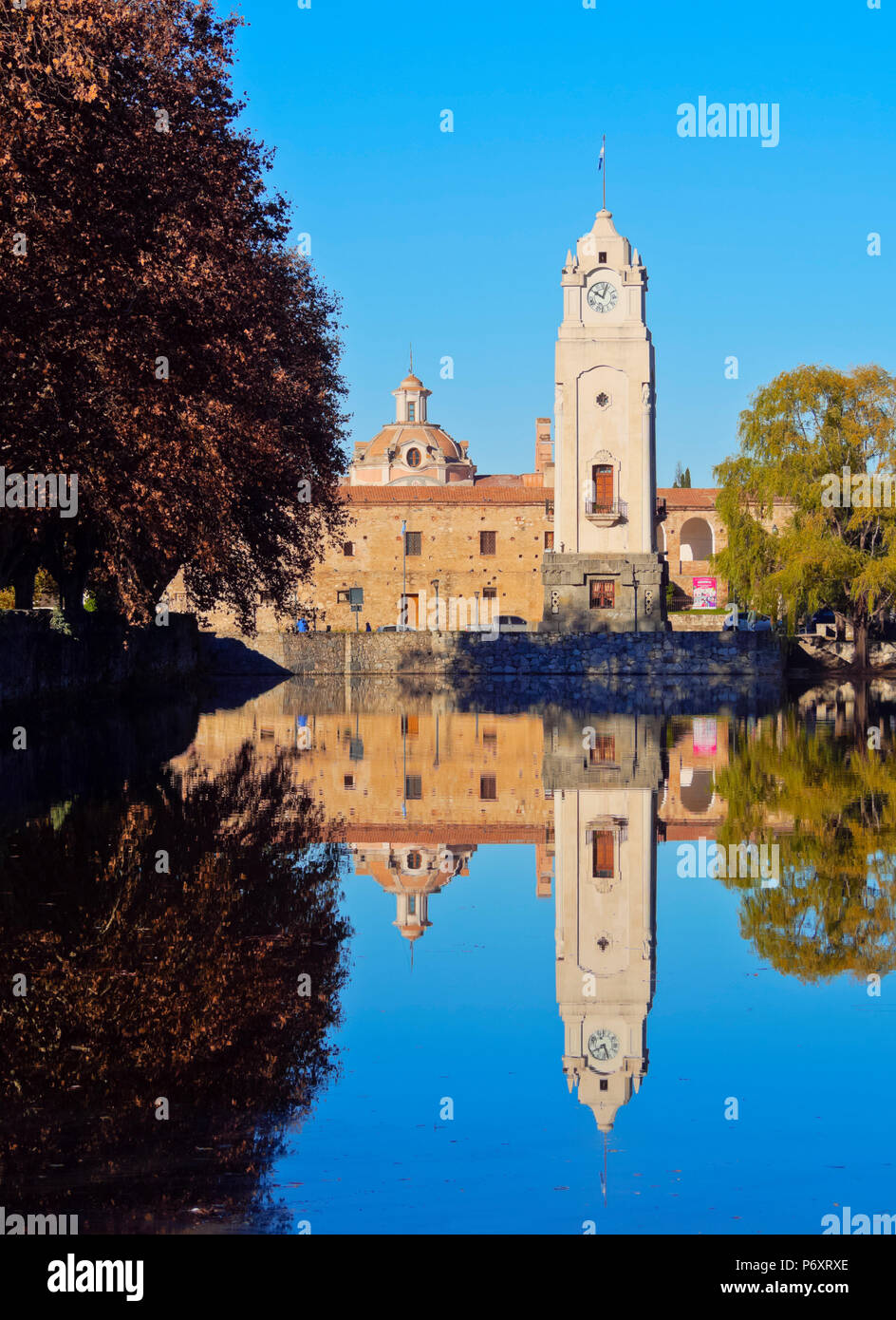 Argentina, Cordoba Province, Alta Gracia, View of El Tajamar Water Reservoir build by Jesuits, the Clock Tower and the Jesuit Estancia. - Stock Image