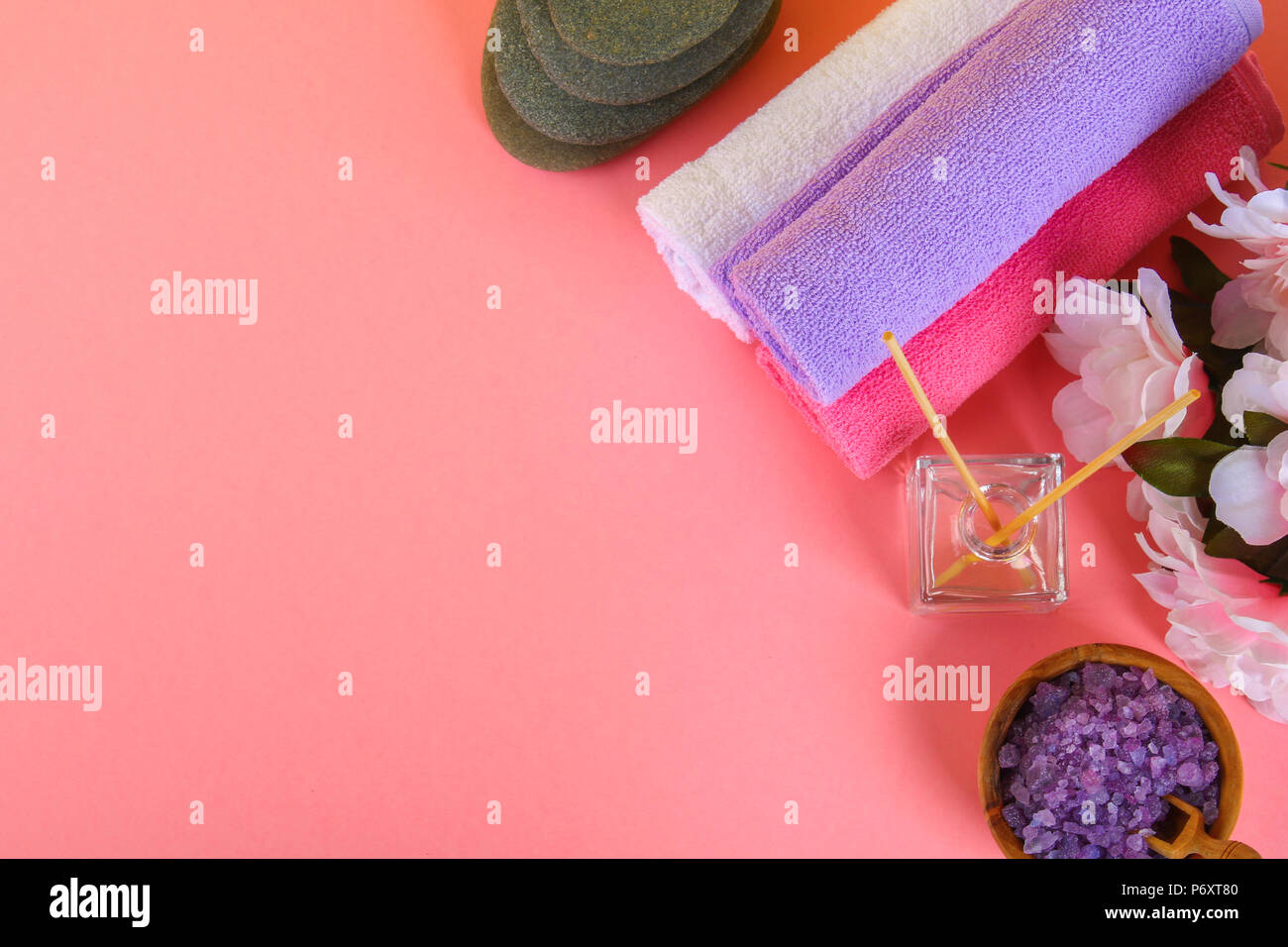 Spa on a pink pastel background towels stones aromamaslo purple spa on a pink pastel background towels stones aromamaslo purple salt bath and pink flowers mightylinksfo