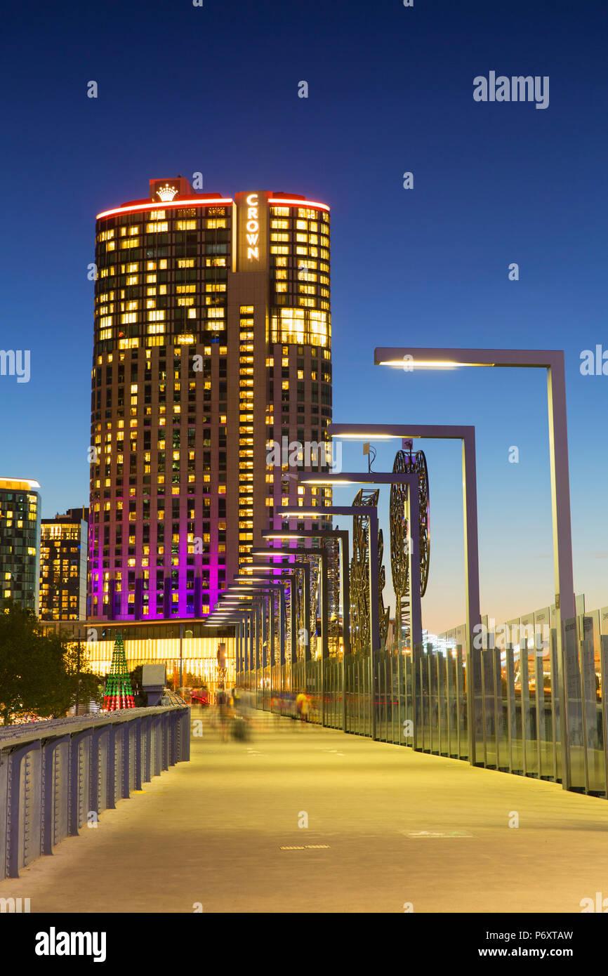Crown Casino and Sandridge Bridge at dusk, Melbourne, Victoria, Australia - Stock Image
