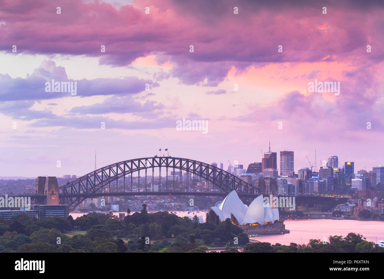 View of Sydney Harbour Bridge and Sydney Opera House at sunset, Sydney, New South Wales, Australia - Stock Image