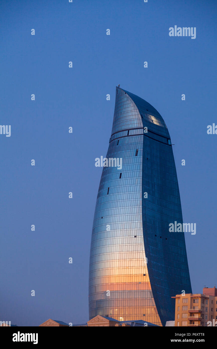 Azerbaijan, Baku, View of one of the three Flame Towers at dawn Stock Photo