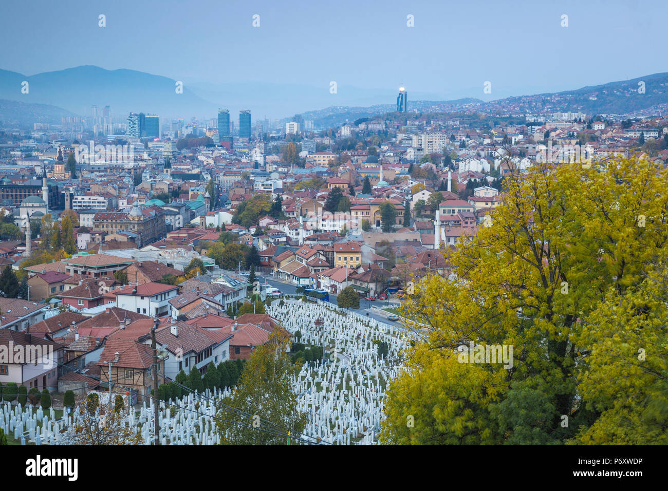 Bosnia and Herzegovina, Sarajevo, View over Kovaci War Memorial and Cemetery to the City - Stock Image