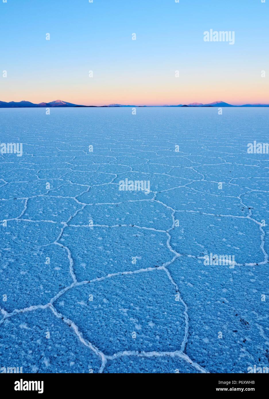 Bolivia, Potosi Department, Daniel Campos Province, View of the Salar de Uyuni, the largest salt flat in the world at sunrise. Stock Photo