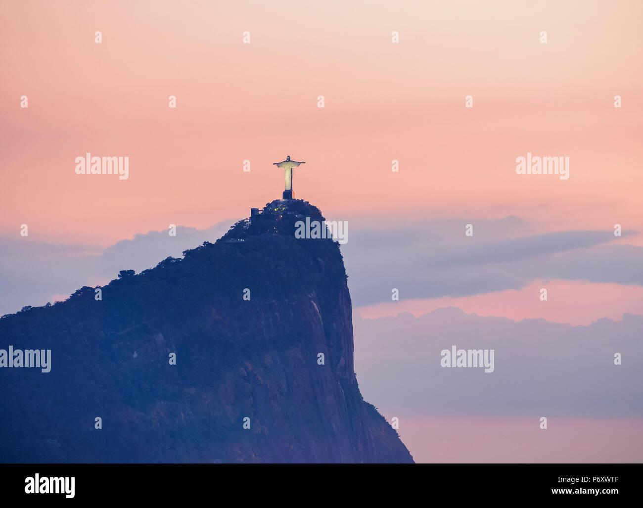 Christ the Redeemer and Corcovado Mountain at sunrise, Rio de Janeiro, Brazil Stock Photo