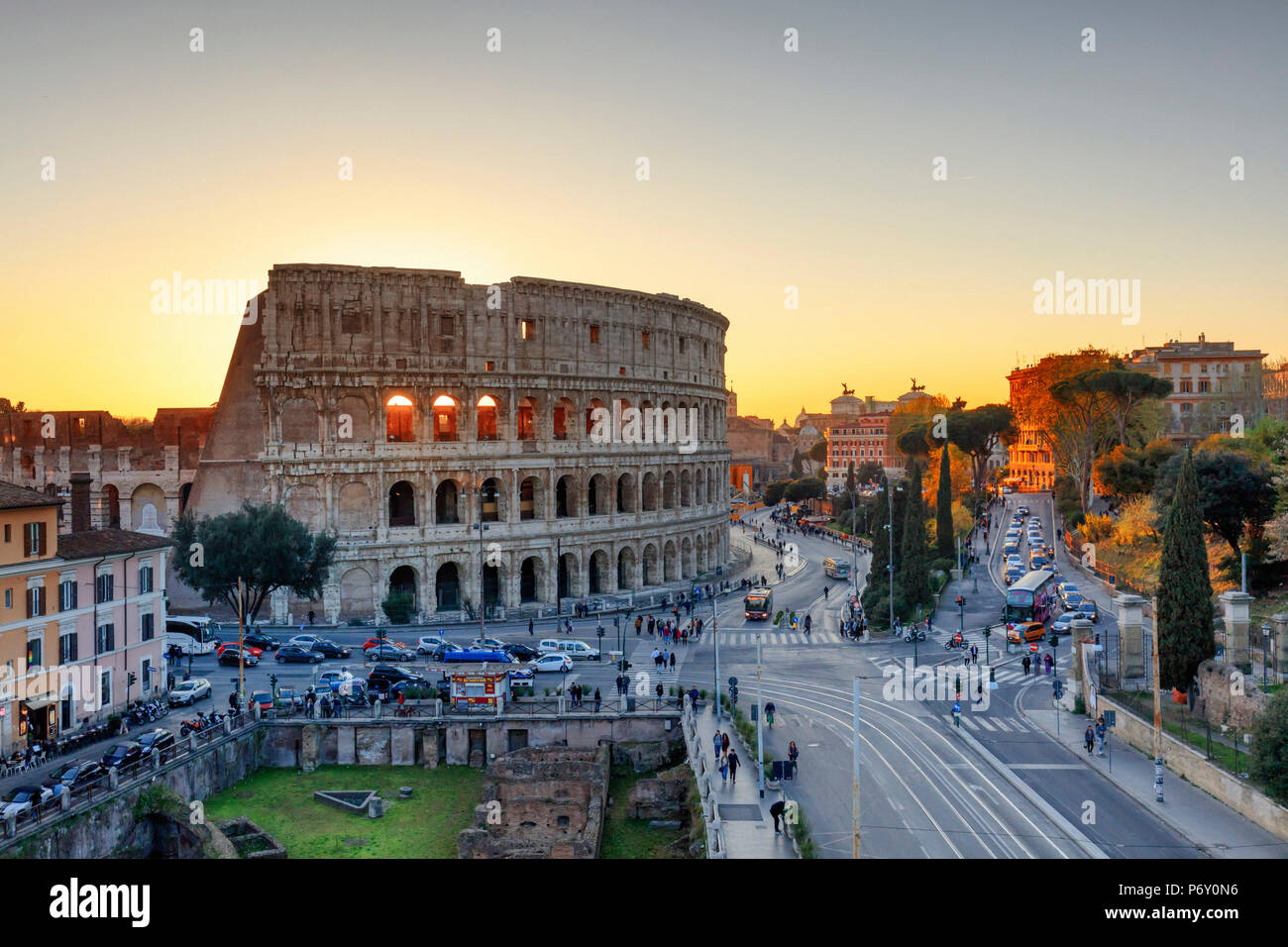 Italy, Rome, Colosseum and Roman Forum at sunset - Stock Image