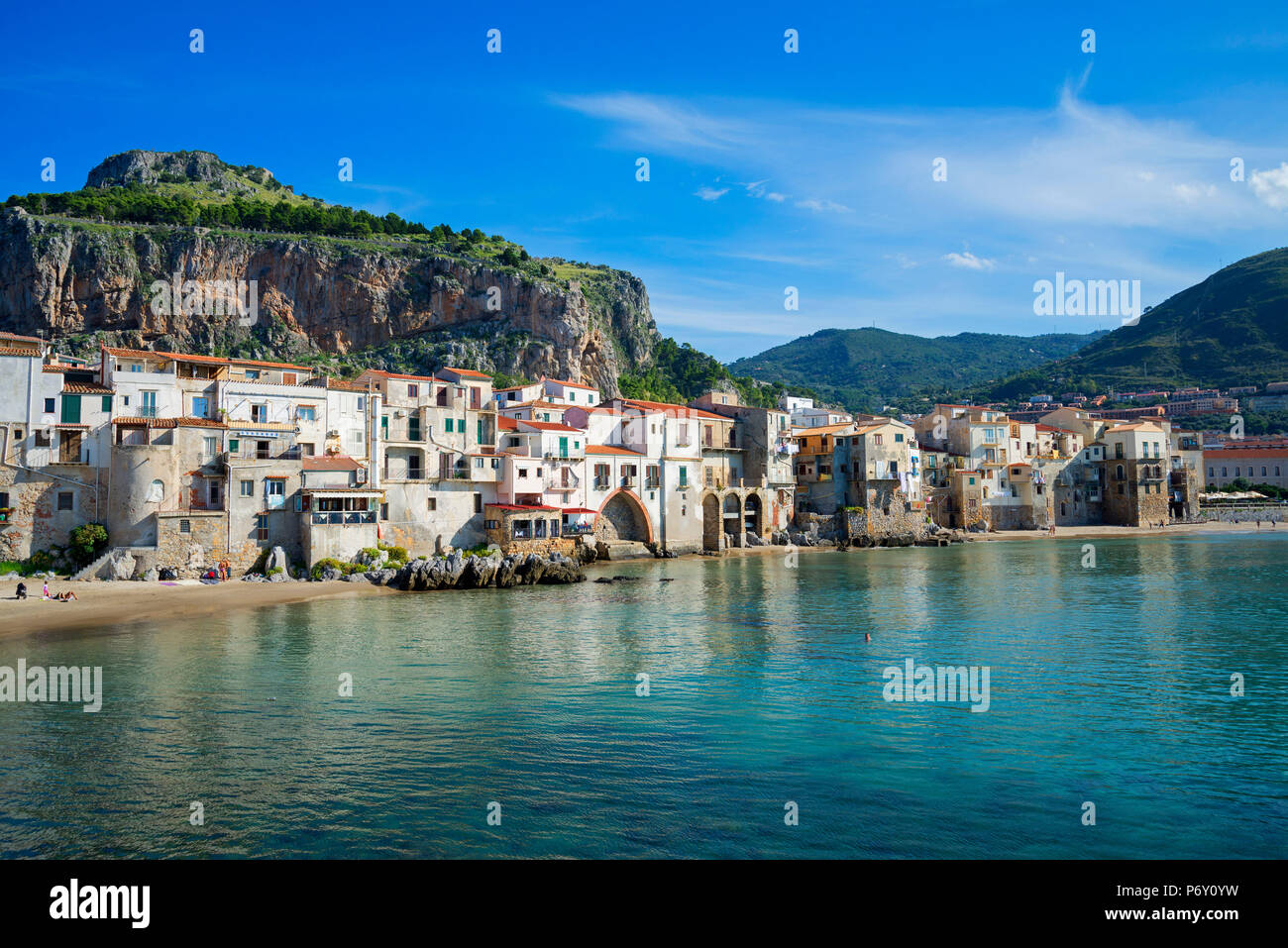 Traditional fishing boats and fishermens houses, Cefalu, Sicily, Italy, Europe - Stock Image