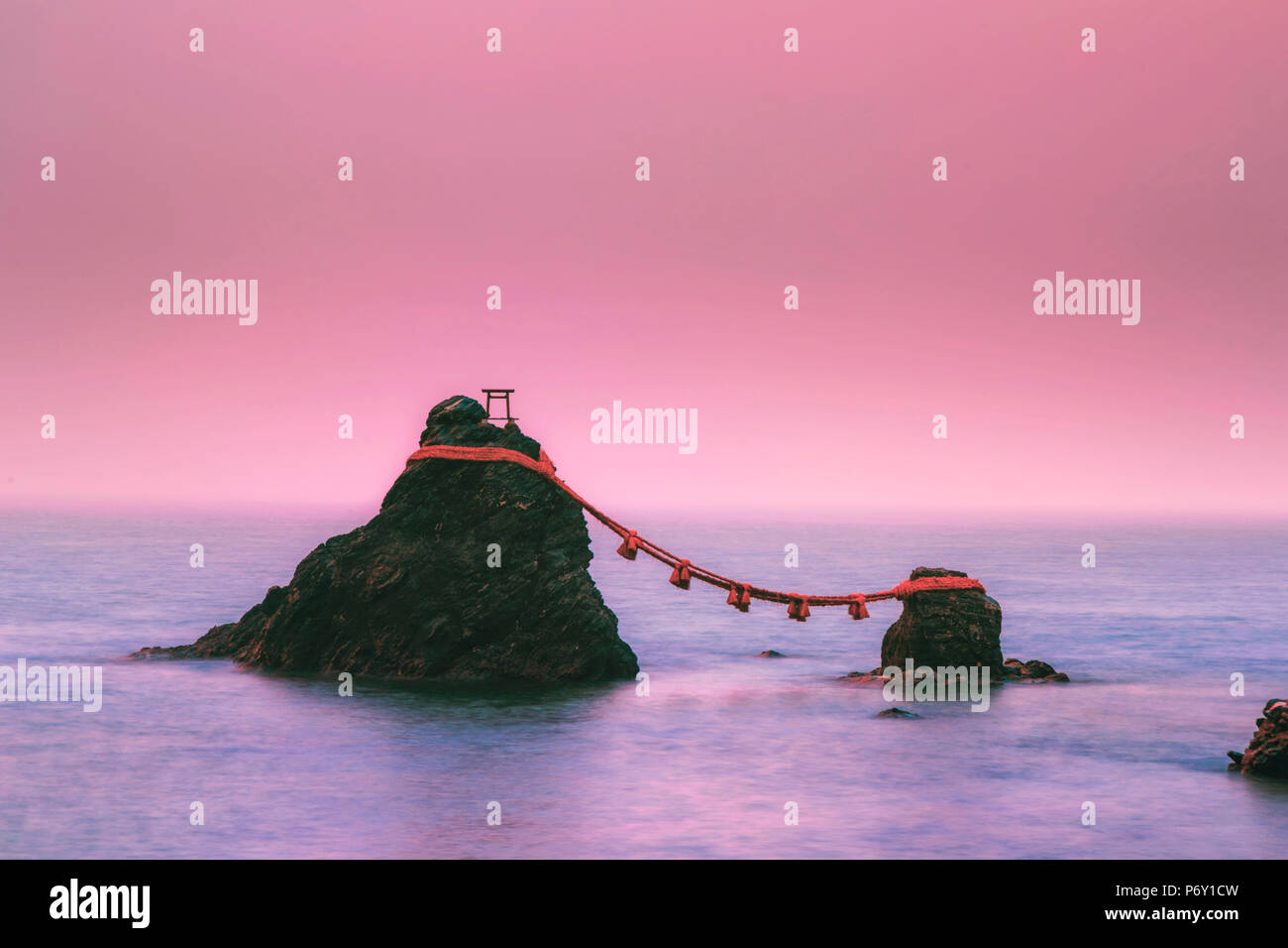 Japan, Mie Prefecture, Futami, Meoto-Iwa (Wedded Rocks)  just offshore from Okiyama Shrine, revered as representations of Izanagi and Izanami, the two gods who created Japan. - Stock Image
