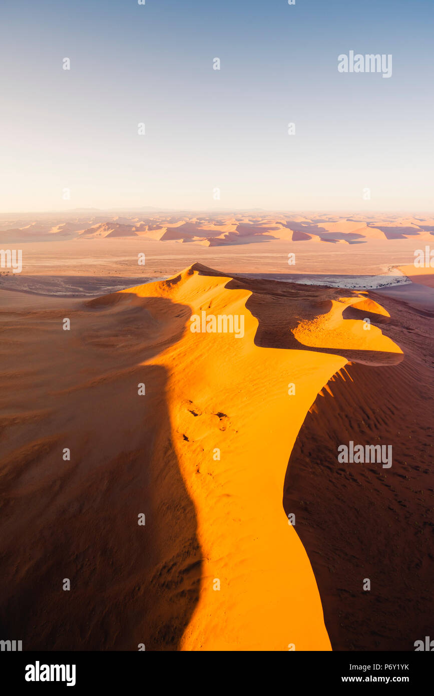 Sossusvlei, Namib-Naukluft National Park, Namibia, Africa. Aerial view of the sand dunes at sunrise. - Stock Image
