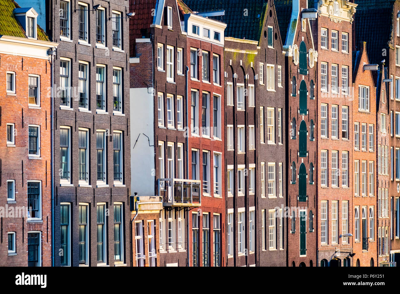 Netherlands, North Holland, Amsterdam. Crooked facades of canal houses on Damrak. - Stock Image