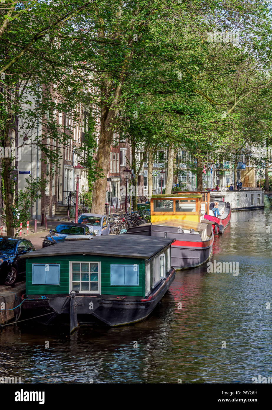 Houseboats on Raamgracht Canal, Amsterdam, North Holland, The Netherlands - Stock Image