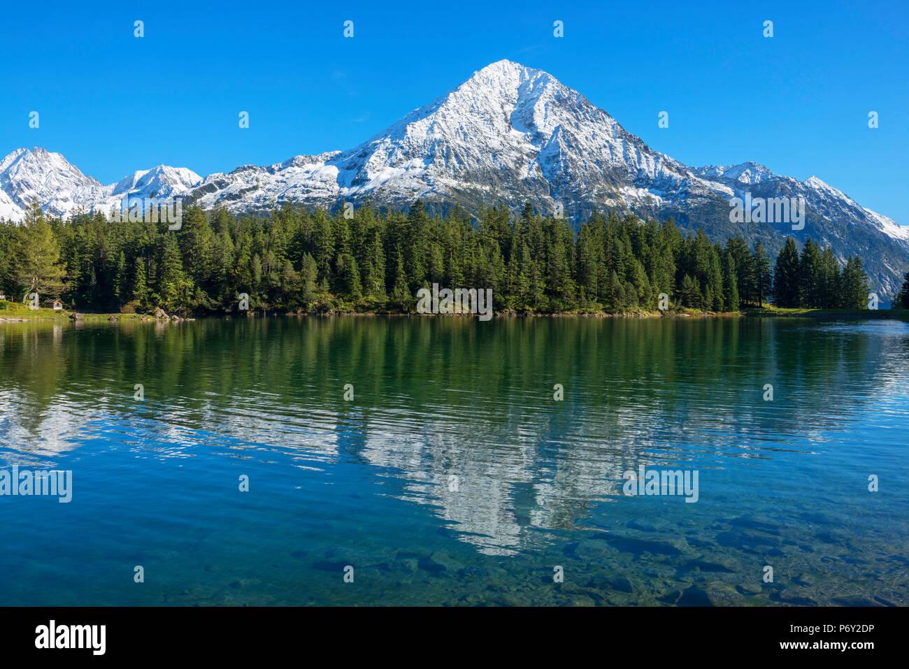 Arni lake with Bristen mountain at fall, Uri, Switzerland - Stock Image