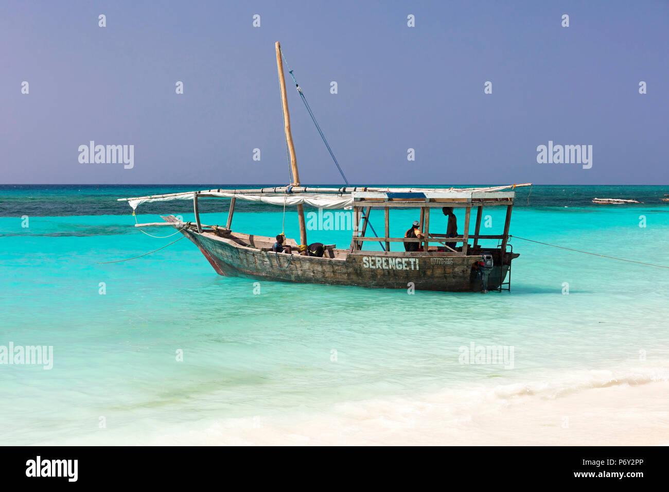 A traditional dhow is moored at Nugwi beach, Zanzibar, Tanzania - Stock Image