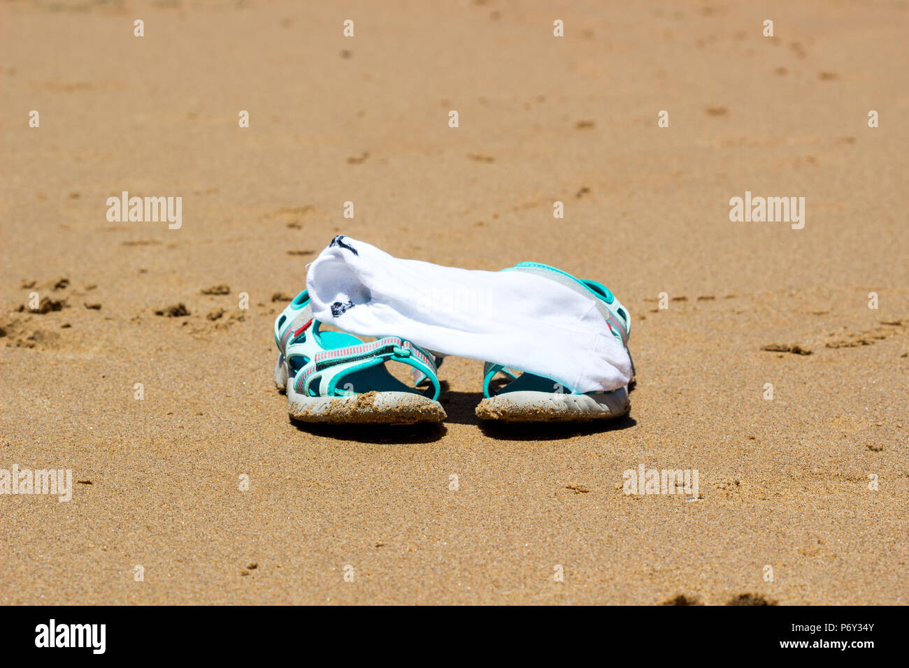 503e35182e18 Summer vacation concept. Flip flops on a sandy ocean beach   Shoes in the  Beach on Sand