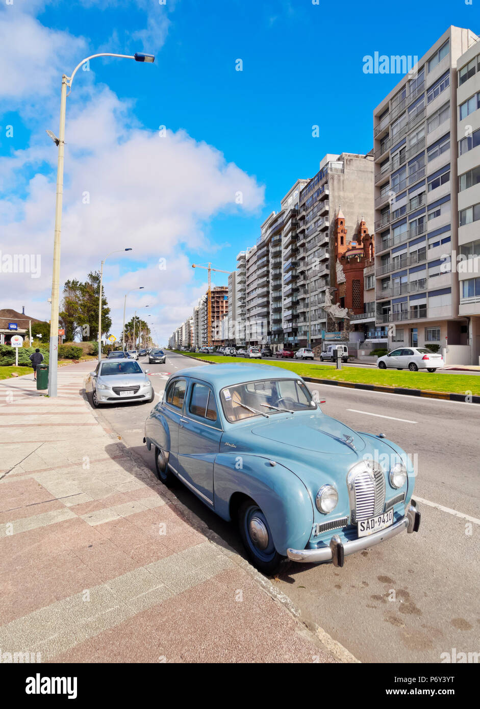 Uruguay, Montevideo, Vintage car parked by the Rambla. - Stock Image