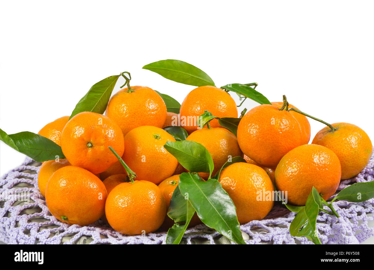Bunch of fresh tangerines oranges in white background. - Stock Image