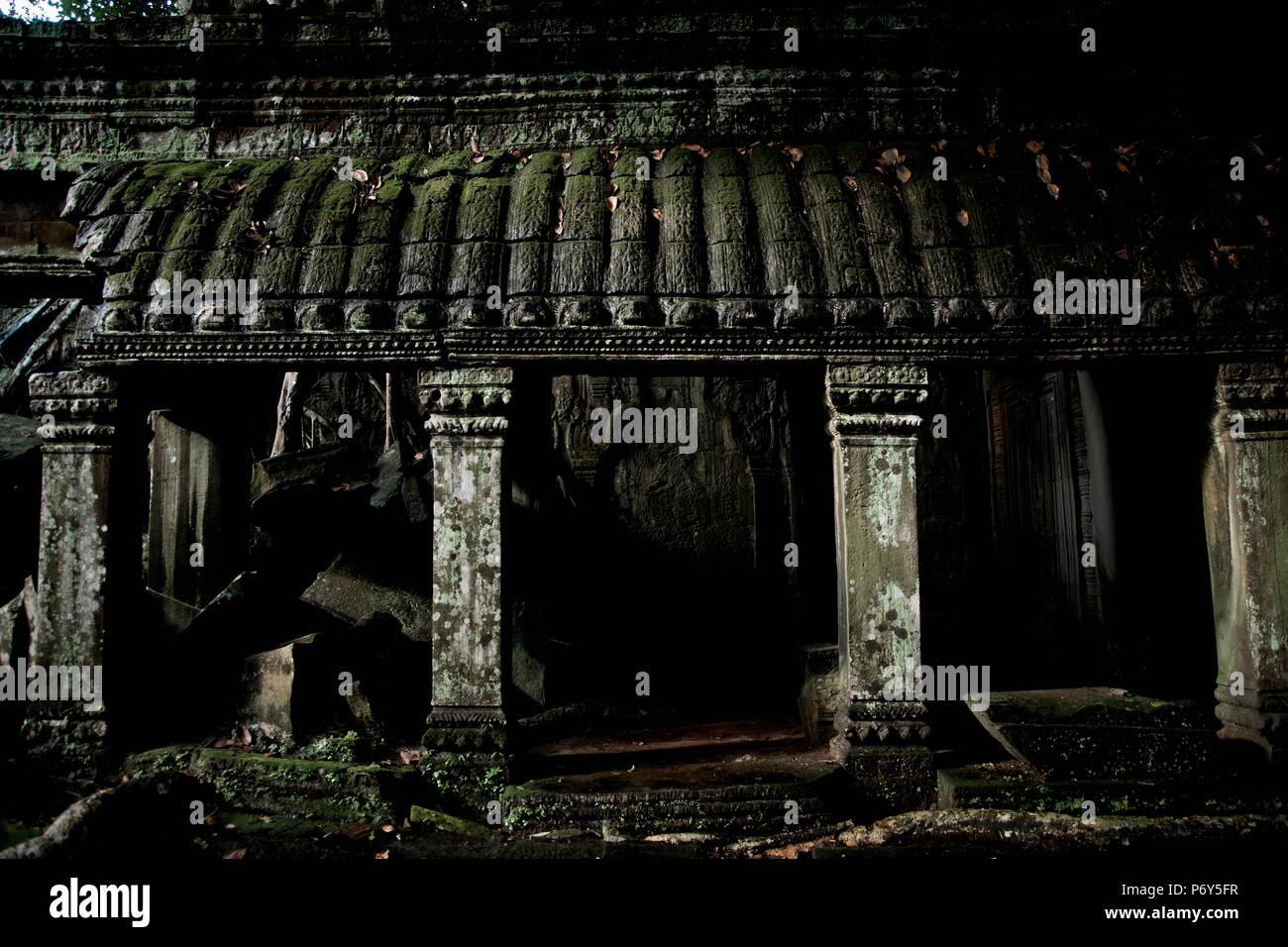 Panoramic of Angkor Wat, ancient Cambodian city hidden in the forest, visited by tourists - Stock Image