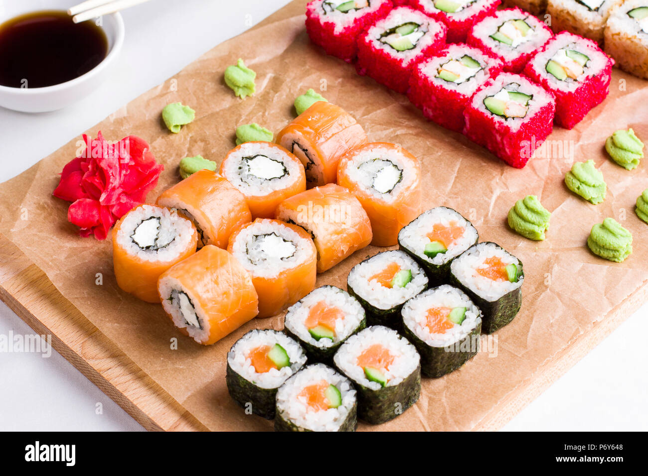 Set Of Different Types Of Japanese Sushi Rolls On Wooden Board Stock Photo Alamy