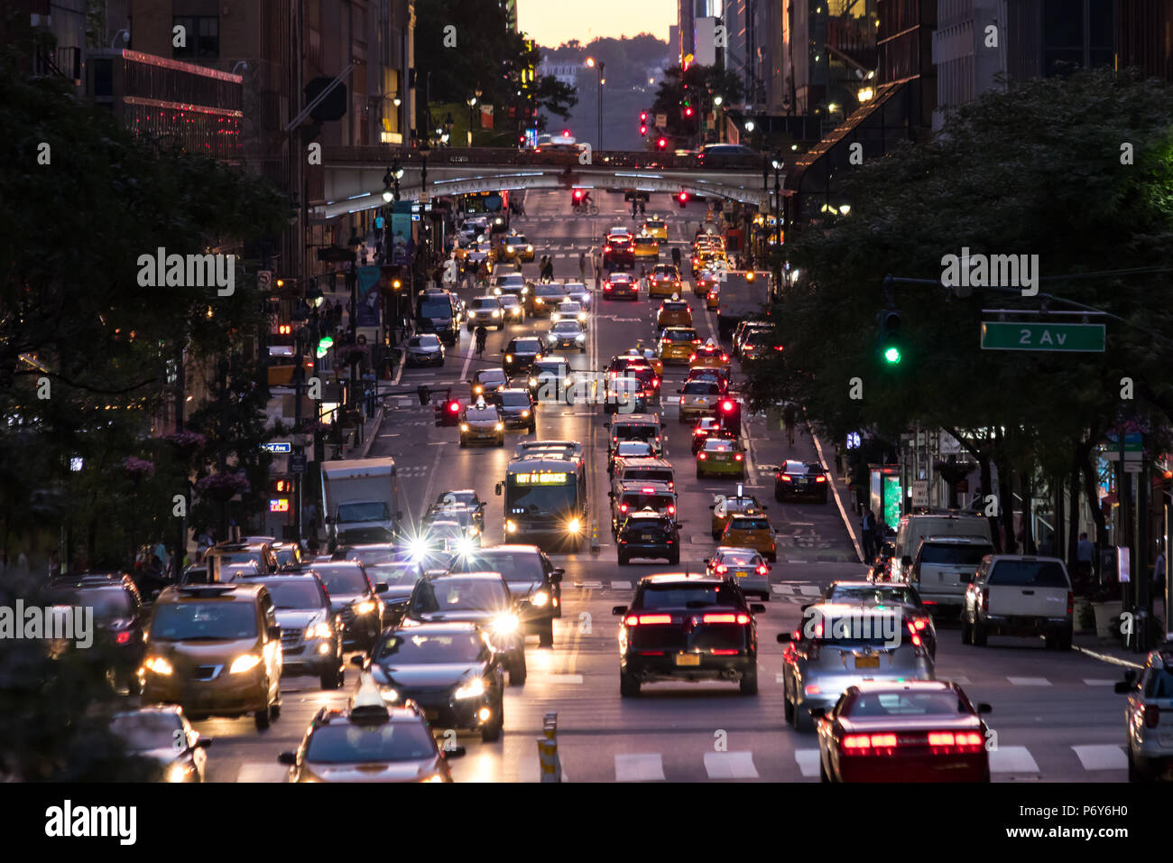 Lights from crosstown traffic on 42nd Street in Midtown Manhattan New York City - Stock Image