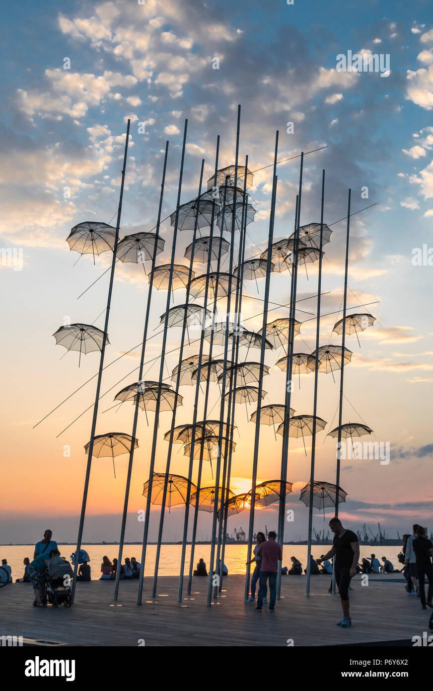 Georgios Zongolopoulos umbrellas sculpture at sunset on Thessaloniki waterfront, Macedonia, Northern Greece - Stock Image