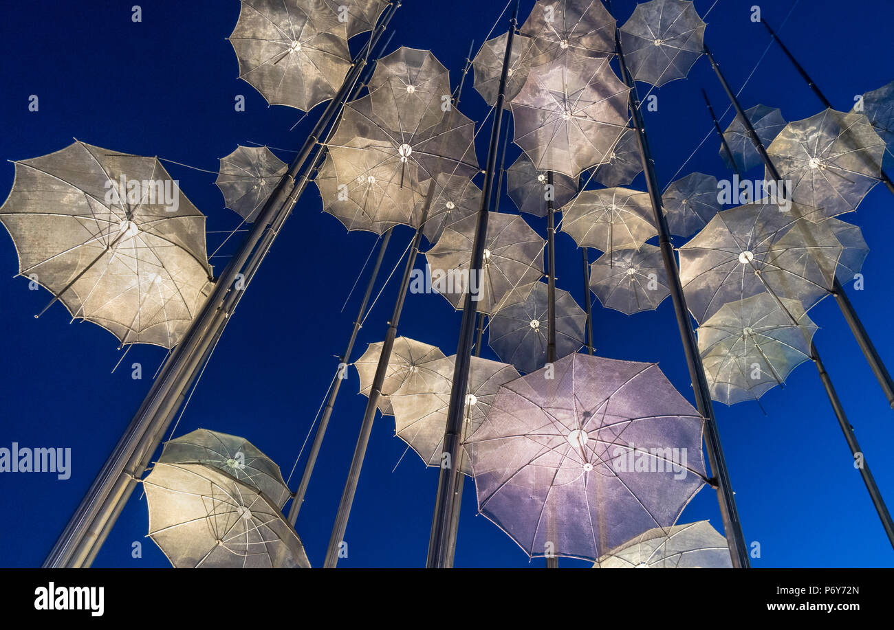 Georgios Zongolopoulos umbrellas sculpture at night, on Thessaloniki waterfront, Macedonia, Northern Greece - Stock Image