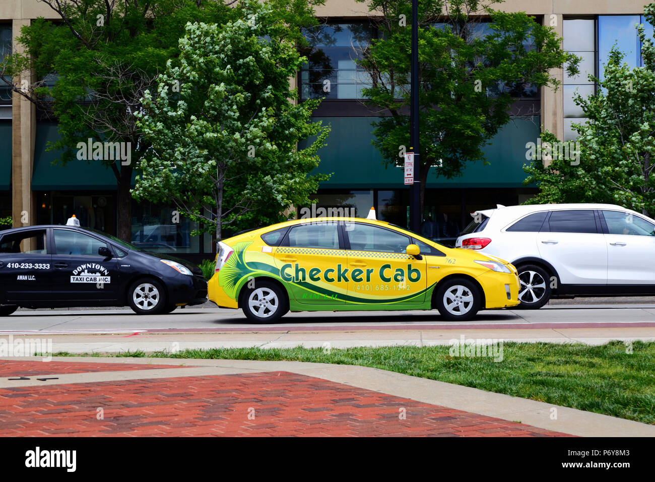 Checker cab taxi near Harborplace, Baltimore, Maryland, USA Stock Photo