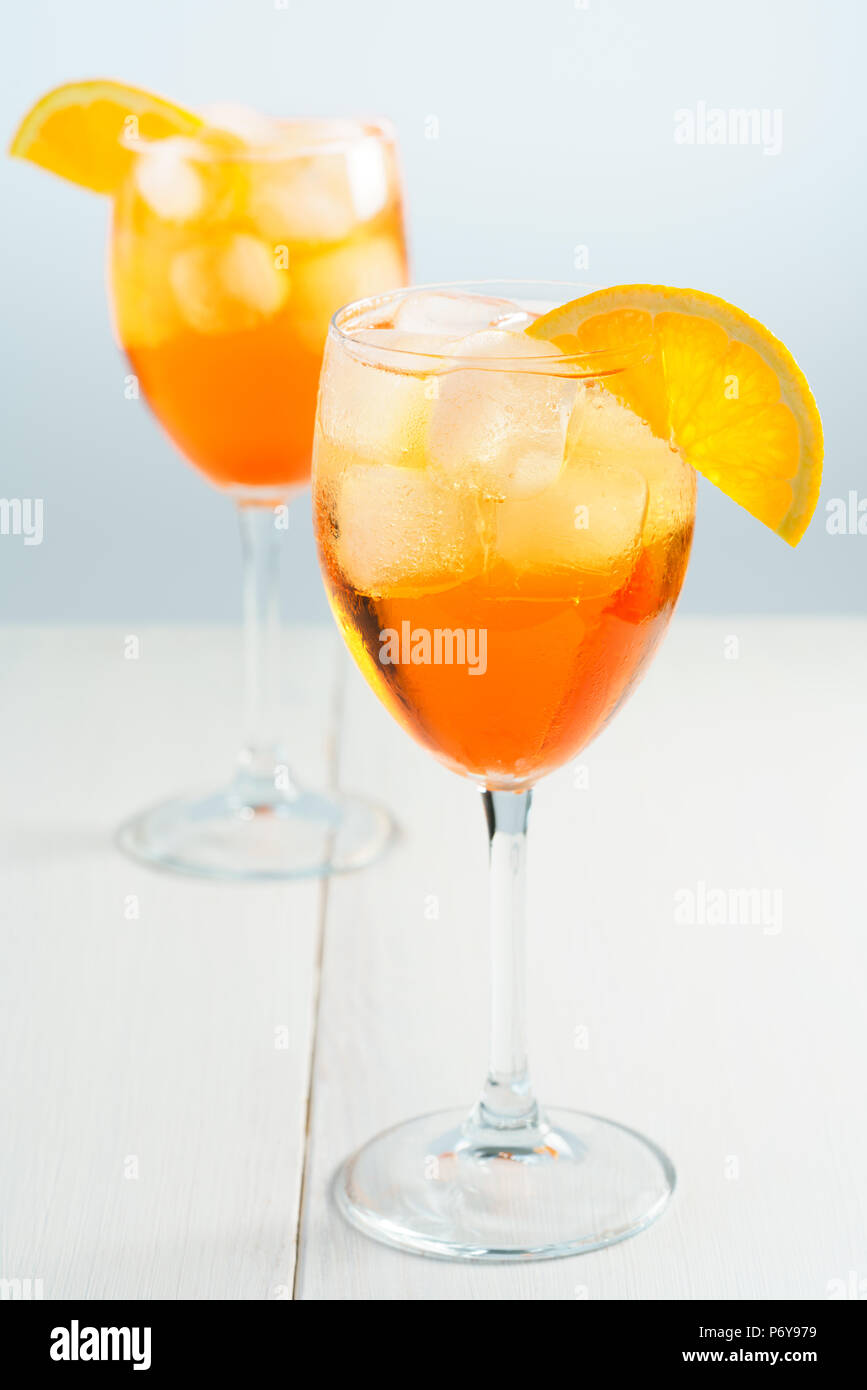 Aperol Spritz served with an orange slice in wine glasses. White background, high resolution - Stock Image