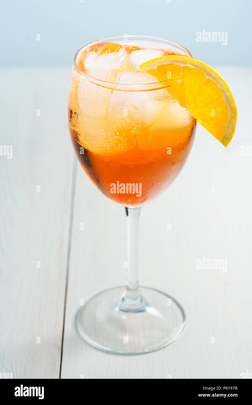 Aperol Spritz served with an orange slice in wine glass. White background, high resolution - Stock Image