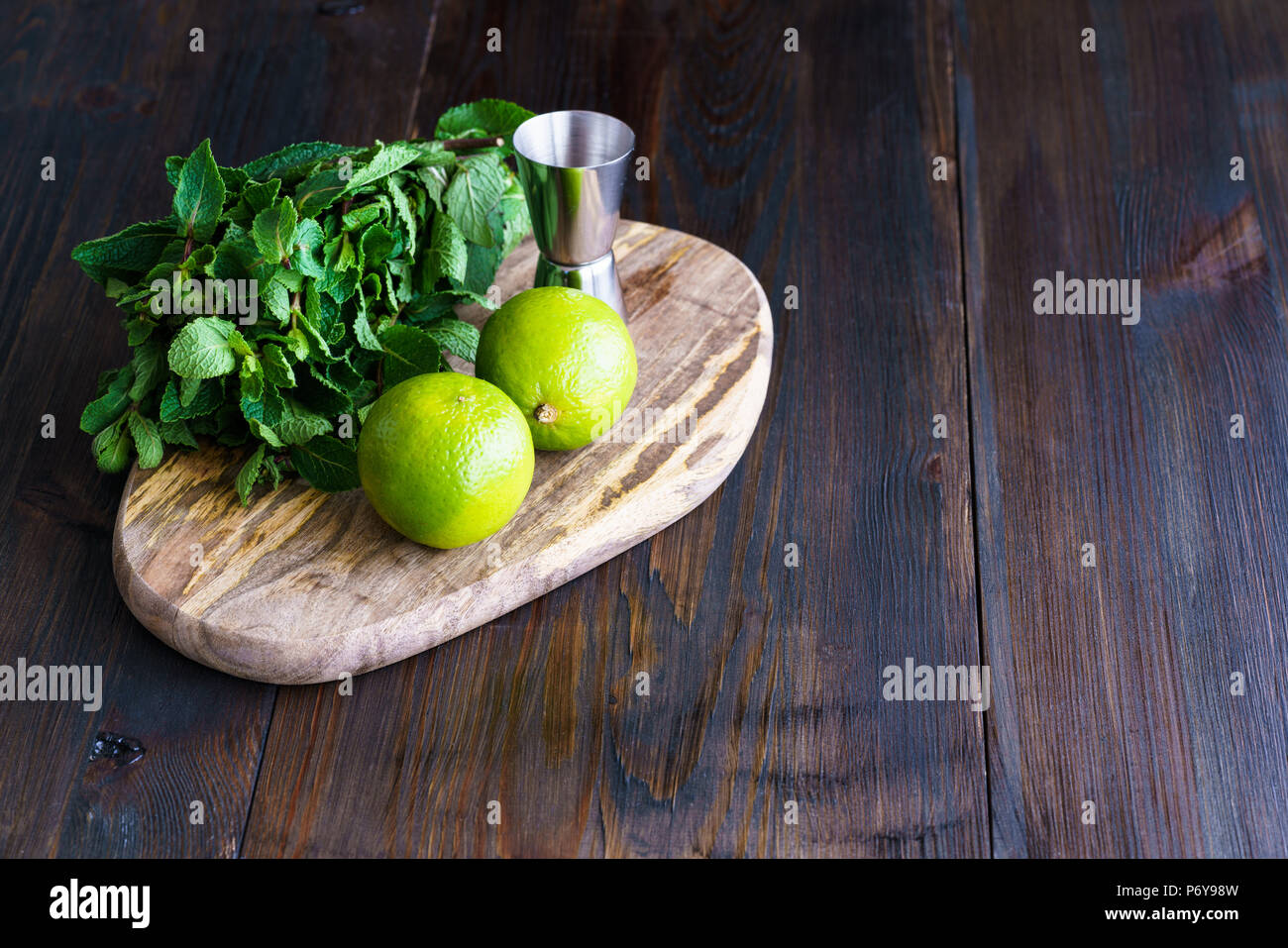 Fresh Mint Limes And Jigger On A Wooden Board Dark